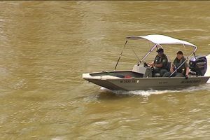 Indiana Conservation officers searching for the body of Lianne Wiscaver on Friday.