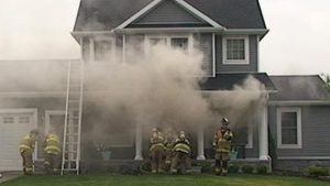 Heavy smoke coming from the Foy home  as JFD crews arrive.