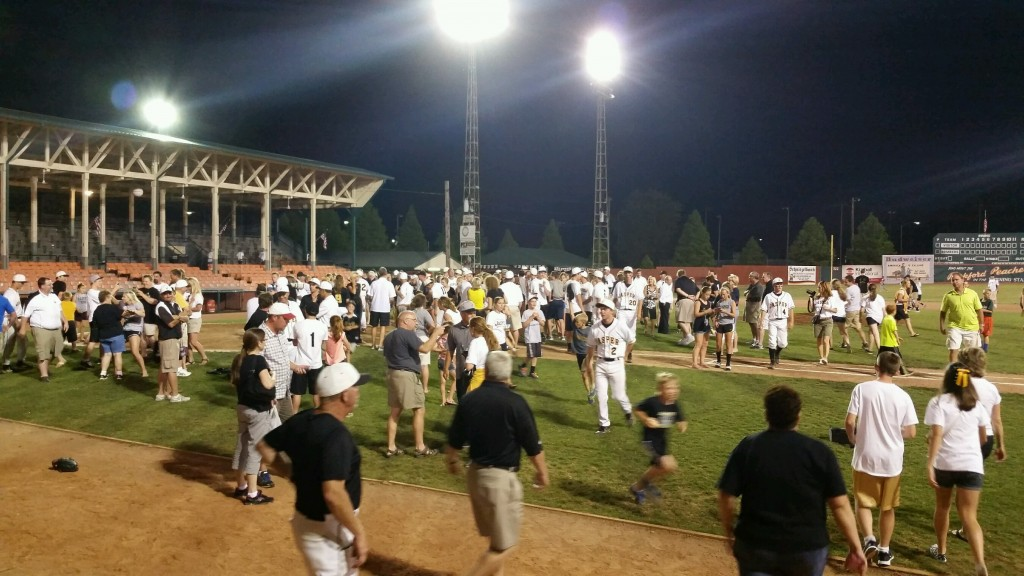 Jasper fans celebrating with the Wildcats after defeating Mt. Vernon to win the local 3A Regional at League Stadium.