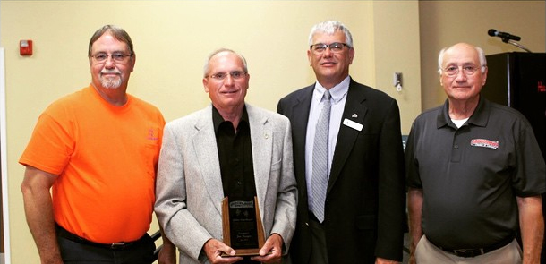 """Jim Rueger pictured second from left with his Huntingburg Chamber of Commerce """"Gold Leaf Award"""" for his career of service to the community.  With Rueger are (L-R) Dale Payne (Huntingburg Parks Department), Mayor Denny Spinner, and former Mayor Gail Kemp. Photo: Huntingburg Chamber of Commerce"""